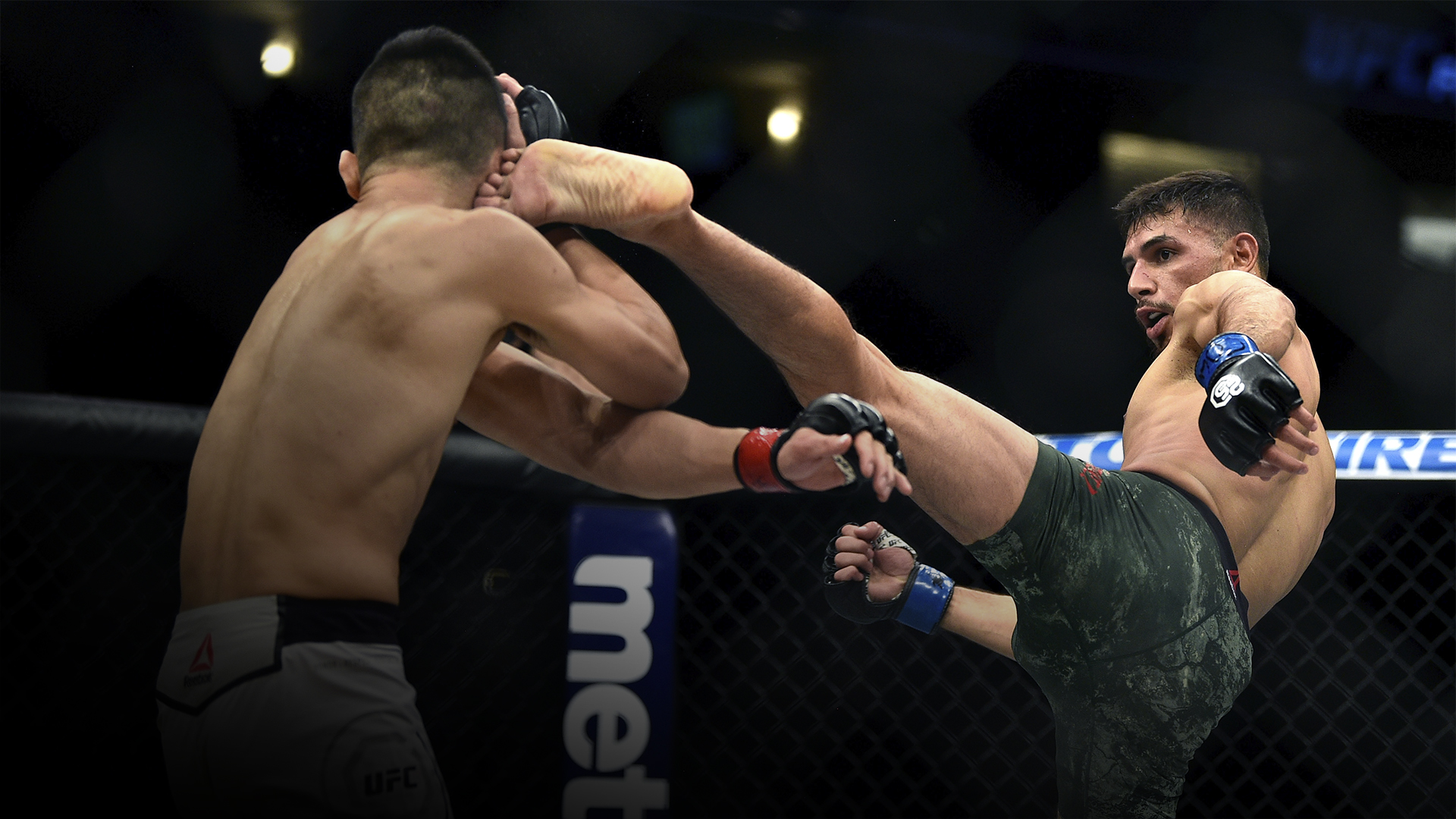 DENVER, CO - NOVEMBER 10: (R-L) Yair Rodriguez of Mexico kicks Chan Sung Jung of South Korea in their featherweight bout during the UFC Fight Night event inside Pepsi Center on November 10, 2018 in Denver, Colorado. (Photo by Chris Unger/Zuffa LLC/Zuffa LLC via Getty Images)