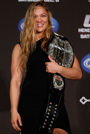 SEATTLE, WA - DECEMBER 06:  Ronda Rousey poses for photos after being presented with the UFC women's bantamweight championship during the UFC on FOX press conference on December 6, 2012 at Key Arena in Seattle, Washington.  (Photo by Josh Hedges/Zuffa LLC