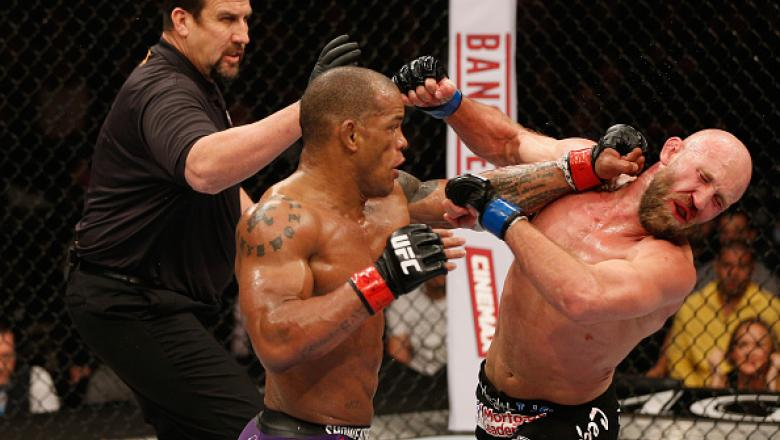 LAS VEGAS, NV - JANUARY 03:  (L-R) Hector Lombard punches Josh Burkman in their welterweight bout during the UFC 182 event on at the MGM Grand Garden Arena January 3, 2015 in Las Vegas, Nevada.  (Photo by Josh Hedges/Zuffa LLC/Zuffa LLC via Getty Images)