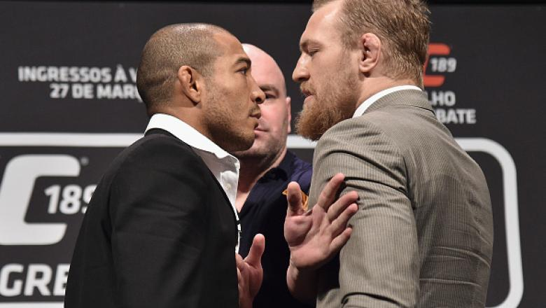 RIO DE JANEIRO, BRAZIL - MARCH 20:  UFC Featherweight Champion Jose Aldo of Brazil (L) and challenger Conor McGregor face off as UFC President Dana White (C) stands in during the 189 World Media Tour Launch press conference at Maracanazinho on March 20, 2