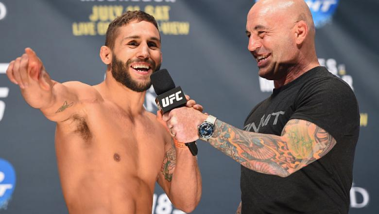 LAS VEGAS, NV - JULY 10:  (L-R) Chad Mendes speaks with Joe Rogan during the UFC 189 weigh-in inside MGM Grand Garden Arena on July 10, 2015 in Las Vegas, Nevada.  (Photo by Josh Hedges/Zuffa LLC)