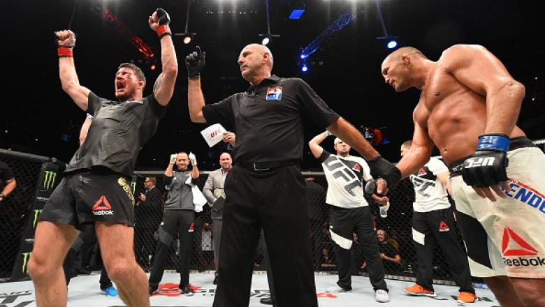 MANCHESTER, ENGLAND - OCTOBER 08:  (L-R) Michael Bisping of England celebrates his victory over Dan Henderson in their UFC middleweight championship bout during the UFC 204 Fight Night at the Manchester Evening News Arena on October 8, 2016 in Manchester,
