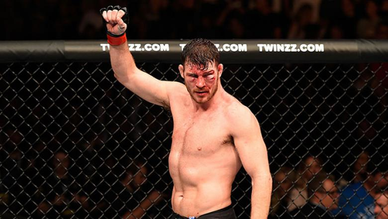 MANCHESTER, ENGLAND - OCTOBER 08:  Michael Bisping of England raises his hand after facing Dan Henderson in their UFC middleweight championship bout during the UFC 204 Fight Night at the Manchester Evening News Arena on October 8, 2016 in Manchester, Engl