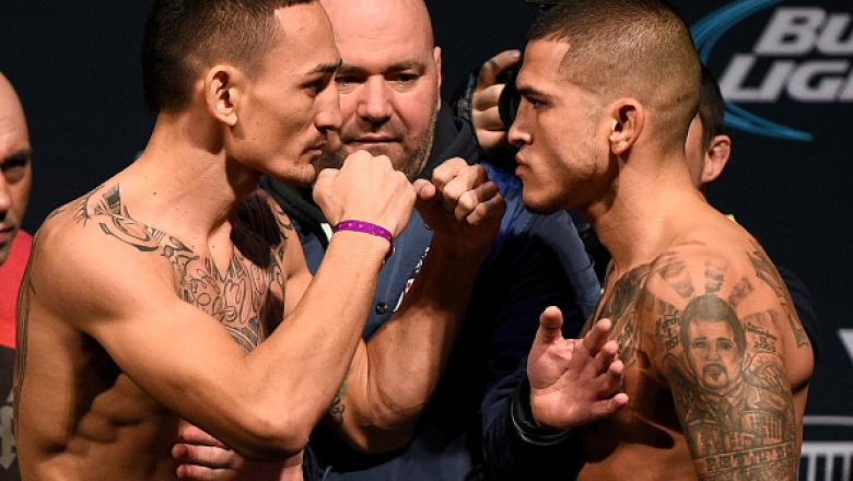 TORONTO, CANADA - DECEMBER 09:  Opponents (L-R) Max Holloway and Anthony Pettis face off during the UFC weigh-in at Air Canada Centre on December 9, 2016 in Toronto, Ontario, Canada. (Photo by Jeff Bottari/Zuffa LLC/Zuffa LLC via Getty Images)
