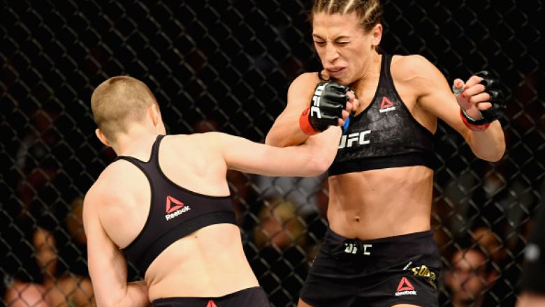 NEW YORK, NY - NOVEMBER 04: Rose Namajunas lands a punch against Joanna Jedrzejczyk of Poland  in their UFC women's strawweight championship bout during the UFC 217 event at Madison Square Garden on November 4, 2017 in New York City.  (Photo by Josh Hedge