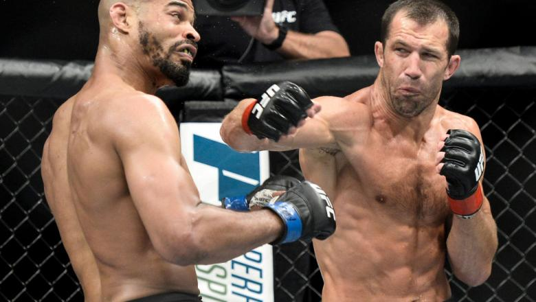 (R-L) Luke Rockhold punches David Branch in their middleweight bout during the UFC Fight Night event inside the PPG Paints Arena on September 16, 2017 in Pittsburgh, Pennsylvania. (Photo by Brandon Magnus/Zuffa LLC)