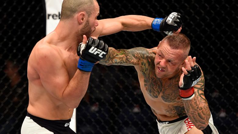 BRISBANE, AUSTRALIA - MARCH 20:   (R-L) Ross Pearson of England punches Chad Laprise of Canada in their lightweight bout during the UFC Fight Night event at the Brisbane Entertainment Centre on March 20, 2016 in Brisbane, Australia. (Photo by Josh Hedges/