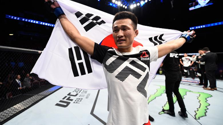 HOUSTON, TX - FEBRUARY 04:  Chan Sung Jung of South Korea celebrates his victory over Dennis Bermudez in their featherweight bout during the UFC Fight Night event at the Toyota Center on February 4, 2017 in Houston, Texas. (Photo by Jeff Bottari/Zuffa LLC