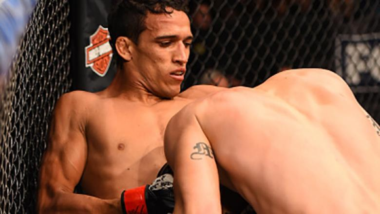 ORLANDO, FL - DECEMBER 19:   (L-R) Charles Oliveira attempts to submit Myles Jury in their featherweight bout during the UFC Fight Night event at the Amway Center on December 19, 2015 in Orlando, Florida. (Photo by Josh Hedges/Zuffa LLC/Zuffa LLC via Gett