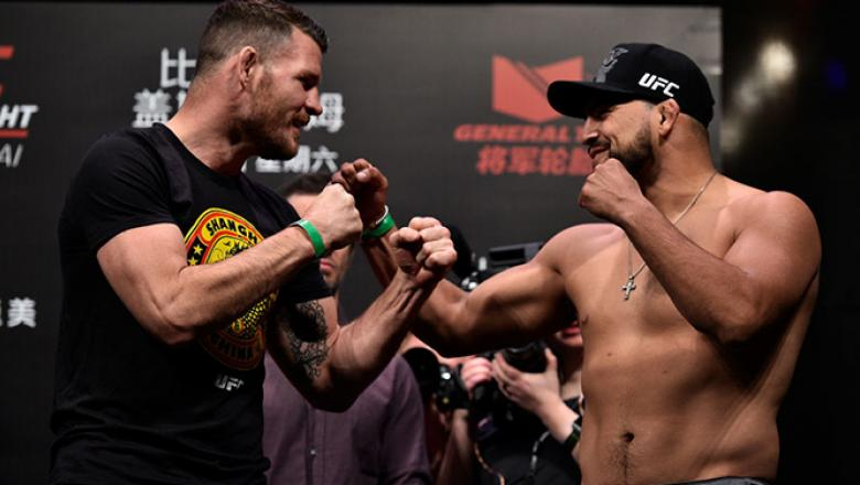 SHANGHAI, CHINA - NOVEMBER 24:  (L-R) Michael Bisping of England and Kelvin Gastelum face off during the UFC Fight Night weigh-in on November 24, 2017 in Shanghai, China. (Photo by Brandon Magnus/Zuffa LLC via Getty Images)