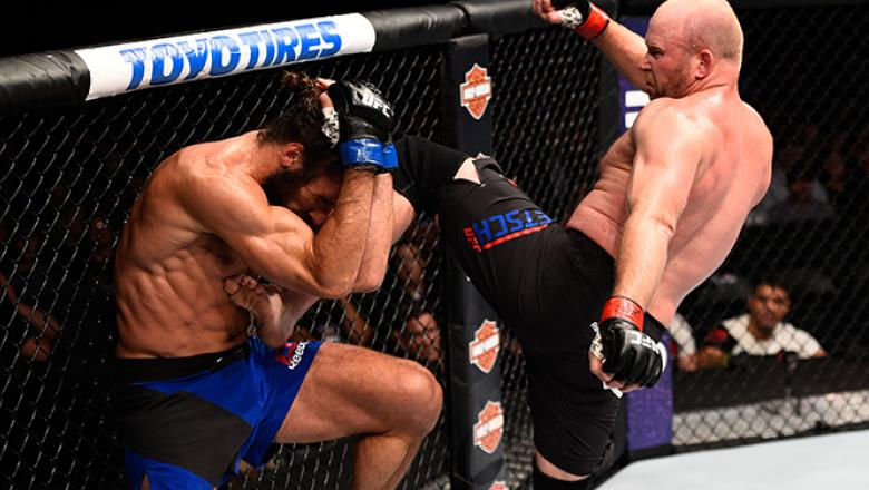 JULY 13: (R-L) Tim Boetsch kicks Josh Samman in their middleweight bout during the UFC Fight Night event on July 13, 2016 at Denny Sanford Premier Center in Sioux Falls, South Dakota. (Photo by Jeff Bottari/Zuffa LLC/Zuffa LLC via Getty Images)