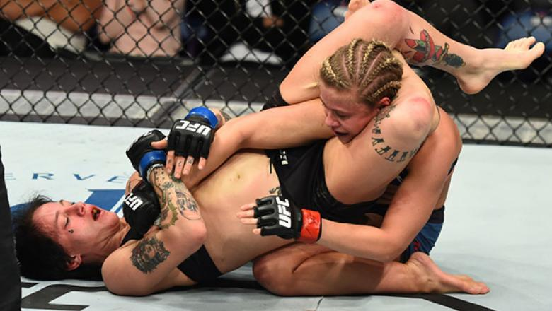 ST. LOUIS, MO - JANUARY 14:  (L-R) Jessica-Rose Clark of Australia attempts to submit Paige VanZant in their women's flyweight bout during the UFC Fight Night event inside the Scottrade Center on January 14, 2018 in St. Louis, Missouri. (Photo by Josh Hed