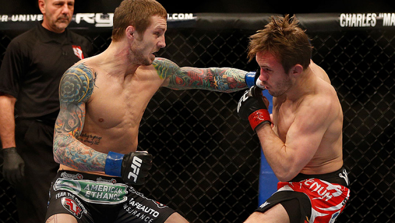 LAS VEGAS, NV - DECEMBER 29:  (L-R) Eddie Wineland punches Brad Pickett during their bantamweight fight at UFC 155 on December 29, 2012 at MGM Grand Garden Arena in Las Vegas, Nevada. (Photo by Josh Hedges/Zuffa LLC/Zuffa LLC via Getty Images) *** Local C
