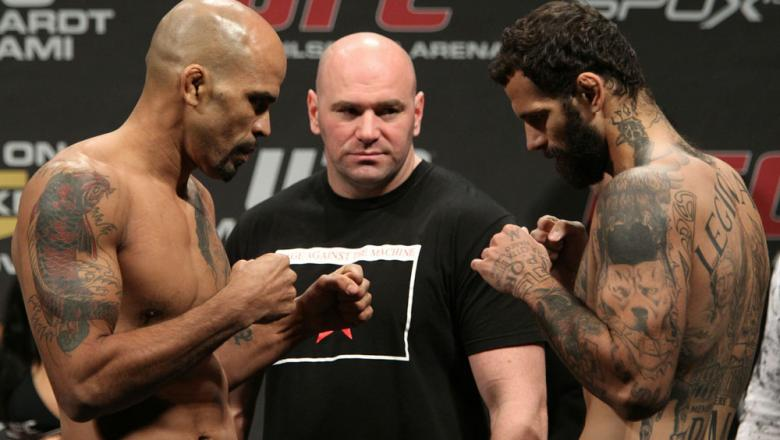 Middleweight opponents Jorge Rivera (L) of United States  and Alessio Sakara (R) of Italy face off as UFC President Dana White looks on at the UFC 122 weigh-in at the Koenig Pilsener Arena on November 12,  2010 in Oberhausen, Germany.  (Photo by Josh Hedg