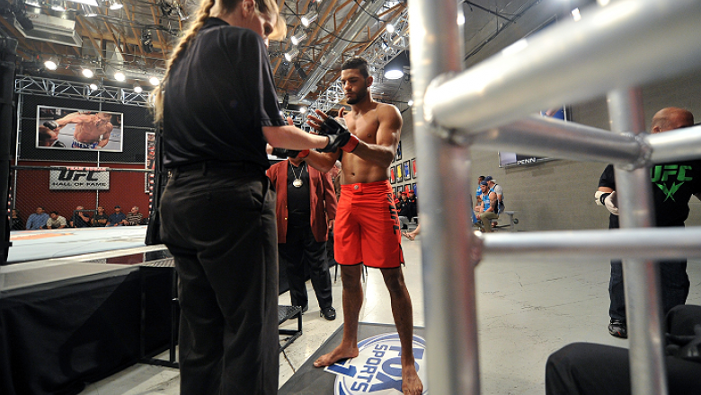 LAS VEGAS, NV - NOVEMBER 1:  (R-L) Team Edgar fighter Dhiego Lima is inspected by referee Kim Winslow before facing team Penn fighter Tim Williams in their preliminary fight during filming of season nineteen of The Ultimate Fighter on November 1, 2013 in