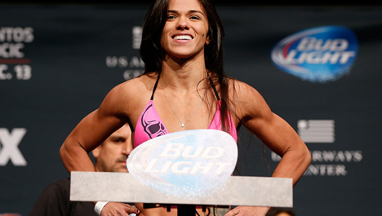 PHOENIX, AZ - DECEMBER 12:  Claudia Gadelha of Brazil poses on the scale after weighing in during the UFC Fight Night weigh-in event at the Phoenix Convention Center on December 12, 2014 in Phoenix, Arizona. (Photo by Josh Hedges/Zuffa LLC/Zuffa LLC via G