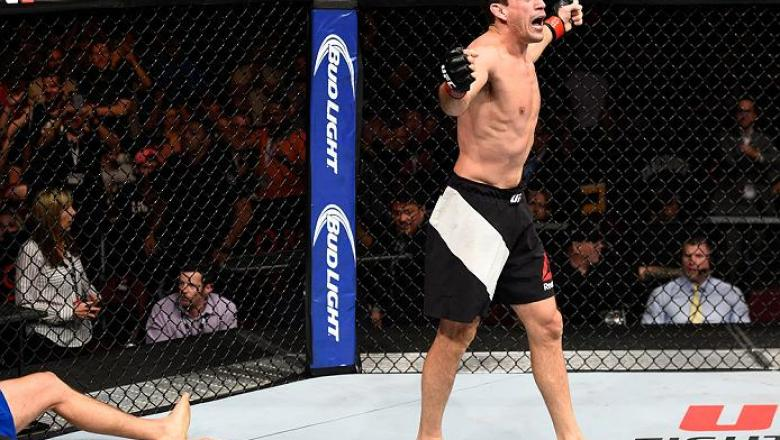 VANCOUVER, BC - AUGUST 27: (R-L) Demian Maia of Brazil celebrates his submission victory over Carlos Condit of the United States in their welterweight bout during the UFC Fight Night event at Rogers Arena on August 27, 2016 in Vancouver, British Columbia,