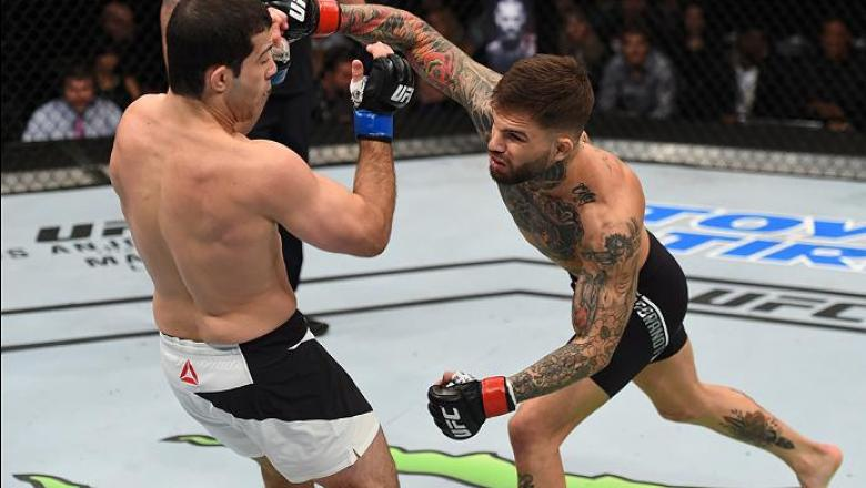 PITTSBURGH, PA - FEBRUARY 21:  (R-L) Cody Garbrandt punches Augusto Mendes in their bantamweight bout during the UFC Fight Night event at Consol Energy Center on February 21, 2016 in Pittsburgh, Pennsylvania. (Photo by Jeff Bottari/Zuffa LLC/Zuffa LLC via