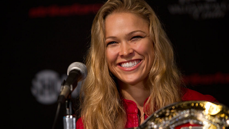 SAN DIEOGO, CA - AUGUST 16: Ronda Rousey interacts with media and fans during the Strikeforce press conference at the Valley View Casino Center on August 16, 2012 in San Diego, Calofornia. (Photo by Esther Lin/Forza LLC)