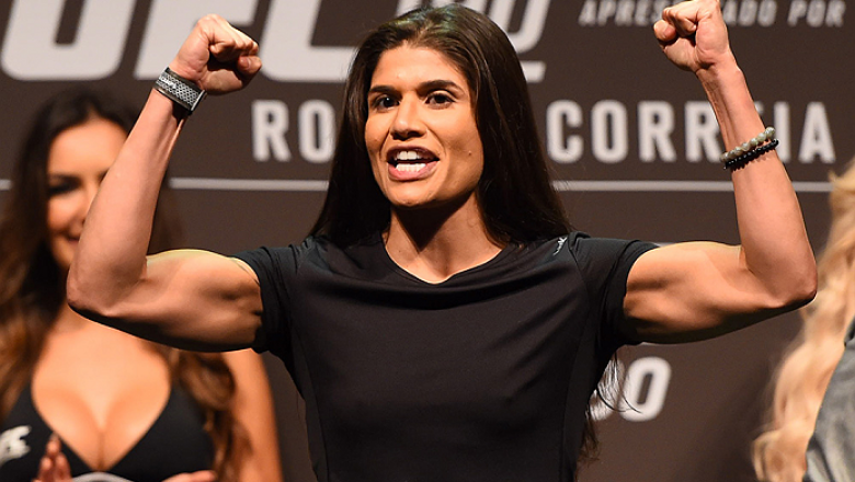RIO DE JANEIRO, BRAZIL - JULY 31:  Jessica Aguilar steps onto the scale during the UFC 190 weigh-in inside HSBC Arena on July 31, 2015 in Rio de Janeiro, Brazil.  (Photo by Josh Hedges/Zuffa LLC/Zuffa LLC via Getty Images)