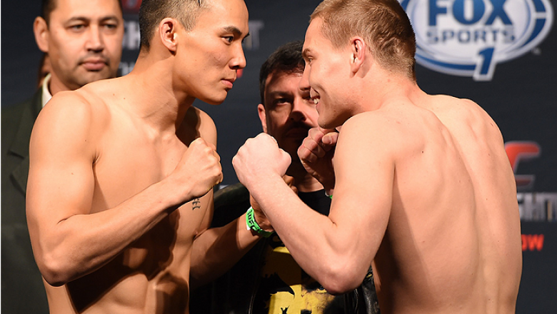 BROOMFIELD, CO - FEBRUARY 13: (L-R) Opponents James Moontasri and Cody Pfister face off during the UFC weigh-in at the 1stBank Center on February 13, 2015 in Broomfield, Colorado. (Photo by Josh Hedges/Zuffa LLC/Zuffa LLC via Getty Images)