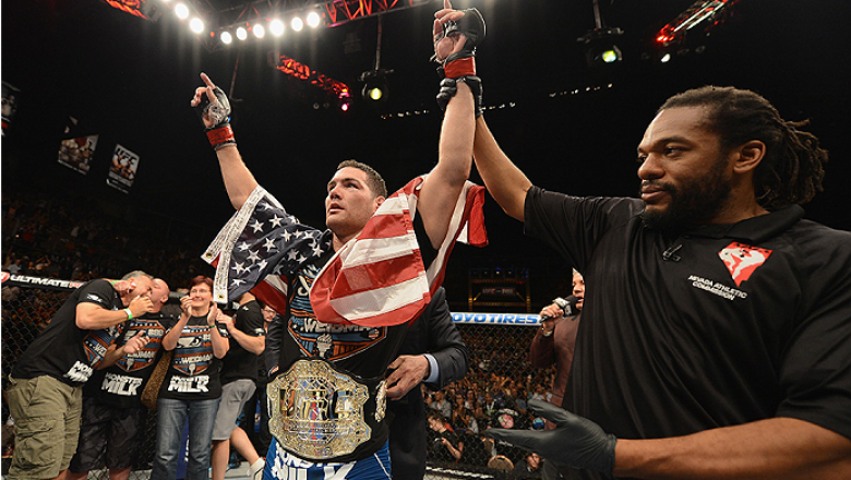LAS VEGAS, NV - JULY 05:  UFC middleweight champion Chris Weidman retains his championship belt after defeating Lyoto Machida in their UFC middleweight championship fight at UFC 175 inside the Mandalay Bay Events Center on July 5, 2014 in Las Vegas, Nevad