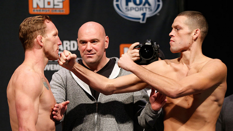 LAS VEGAS, NV - NOVEMBER 29:  (L-R) Opponents Gray Maynard and Nate Diaz face off during the weigh-in for The Ultimate Fighter season 18 live finale inside the Mandalay Bay Events Center on November 29, 2013 in Las Vegas, Nevada. (Photo by Josh Hedges/Zuf