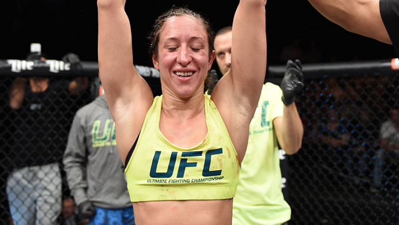 LAS VEGAS, NEVADA - DECEMBER 12:  Jessica Penne celebrates her victory over Randa Markos in their strawweight fight during The Ultimate Fighter Finale event inside the Pearl concert theater at the Palms Casino Resort on December 12, 2014 in Las Vegas, Nev