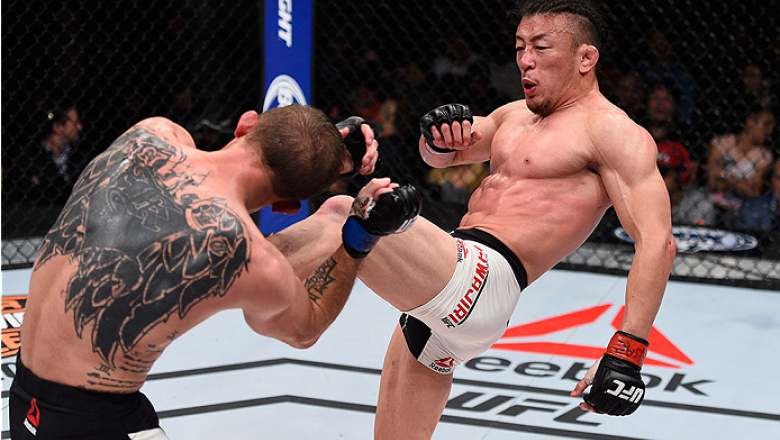 LAS VEGAS, NV - DECEMBER 11:  (R-L) Tatsuya Kawajiri kicks Jason Knight in their featherweight bout during the TUF Finale event inside The Chelsea at The Cosmopolitan of Las Vegas on December 11, 2015 in Las Vegas, Nevada.  (Photo by Jeff Bottari/Zuffa LL
