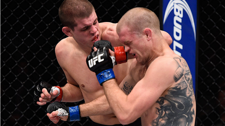 LAS VEGAS, NV - DECEMBER 11: (L-R) Joe Lauzon elbows Evan Dunham in their lightweight bout during the TUF Finale event inside The Chelsea at The Cosmopolitan of Las Vegas on December 11, 2015 in Las Vegas, Nevada.  (Photo by Jeff Bottari/Zuffa LLC/Zuffa L
