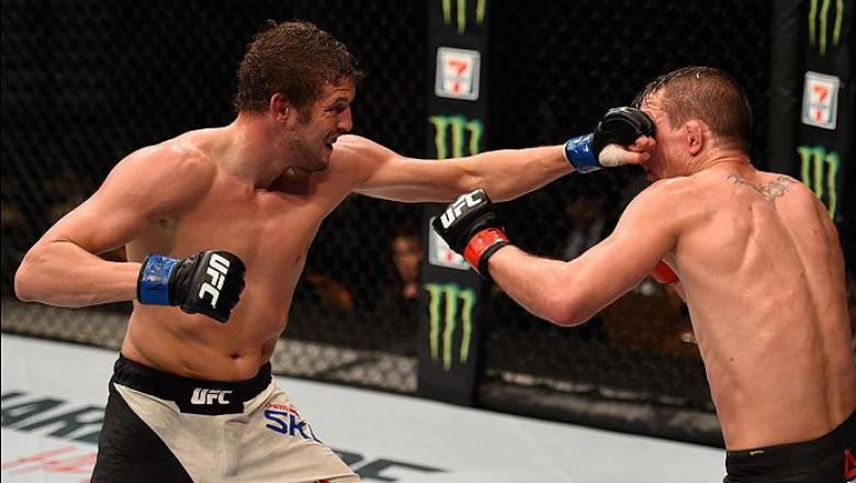 LAS VEGAS, NV - MARCH 05: (L-R) Chas Skelly punches Darren Elkins in their featherweight bout during the UFC 196 event inside MGM Grand Garden Arena on March 5, 2016 in Las Vegas, Nevada.  (Photo by Josh Hedges/Zuffa LLC/Zuffa LLC via Getty Images) *** Lo