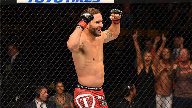 FAIRFAX, VA - APRIL 04:  Chad Mendes celebrates after defeating Ricardo Lamas in their featherweight fight during the UFC Fight Night event at the Patriot Center on April 4, 2015 in Fairfax, Virginia. (Photo by Josh Hedges/Zuffa LLC/Zuffa LLC via Getty Im