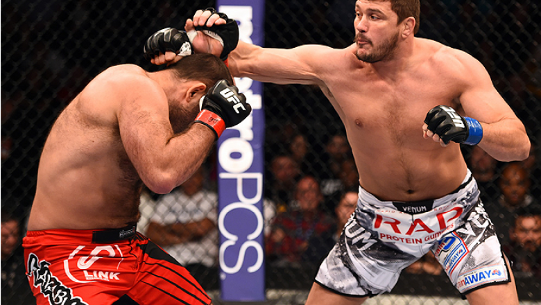 PHOENIX, AZ - DECEMBER 13:  (R-L) Matt Mitrione punches Gabriel Gonzaga of Brazil in their heavyweight fight during the UFC Fight Night event at the U.S. Airways Center on December 13, 2014 in Phoenix, Arizona.  (Photo by Josh Hedges/Zuffa LLC/Zuffa LLC v