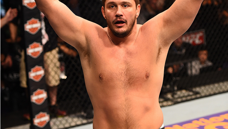 PHOENIX, AZ - DECEMBER 13:  Matt Mitrione celebrates after defeating Gabriel Gonzaga of Brazil in their heavyweight fight during the UFC Fight Night event at the U.S. Airways Center on December 13, 2014 in Phoenix, Arizona.  (Photo by Josh Hedges/Zuffa LL