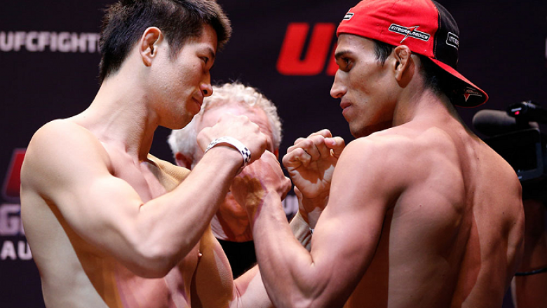 AUCKLAND, NEW ZEALAND - JUNE 27:  (L-R) Opponents Hatsu Hioki of Japan and Charles Oliveira of Brazil during the UFC weigh-in at Vector Arena on June 27, 2014 in Auckland, New Zealand.  (Photo by Josh Hedges/Zuffa LLC/Zuffa LLC via Getty Images)