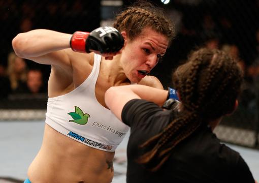 WINNIPEG, CANADA - JUNE 15:  (L-R) Alexis Davis punches Rosi Sexton in their bantamweight fight during the UFC 161 event at the MTS Centre on June 15, 2013 in Winnipeg, Manitoba, Canada.  (Photo by Josh Hedges/Zuffa LLC via Getty Images)