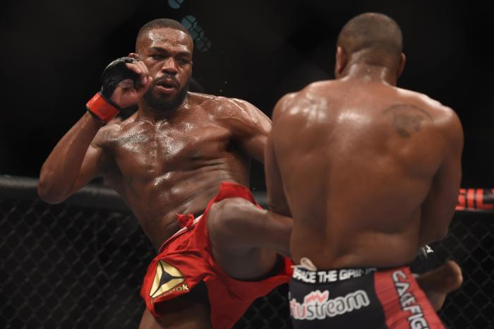 Jon Jones kicks Daniel Cormier in their UFC light heavyweight championship bout during the UFC 182 event at the MGM Grand Garden Arena on January 3, 2015 in Las Vegas, Nevada.