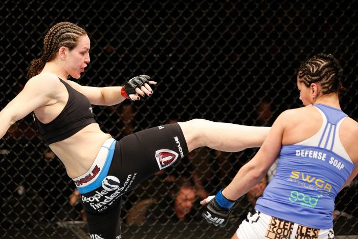 LAS VEGAS, NV - FEBRUARY 22:  (L-R) Alexis Davis kicks Jessica Eye in their women's bantamweight bout during UFC 170 inside the Mandalay Bay Events Center on February 22, 2014 in Las Vegas, Nevada. (Photo by Josh Hedges/Zuffa LLC via Getty Images)