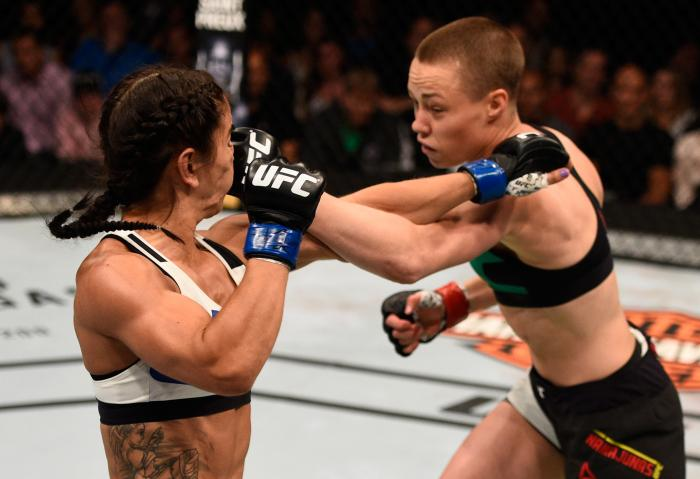 TAMPA, FL - APRIL 16:  (R-L) Rose Namajunas punches Tecia Torres in their women's strawweight bout during the UFC Fight Night event at Amalie Arena on April 16, 2016 in Tampa, Florida. (Photo by Jeff Bottari/Zuffa LLC via Getty Images)