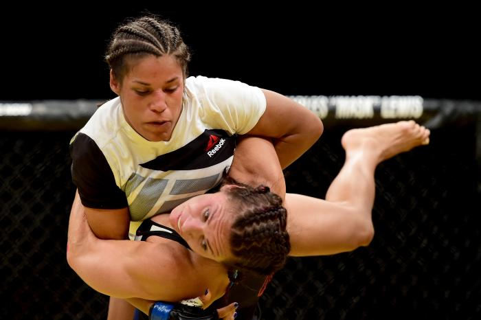 Julianna Pena takes down Cat Zigano in their women's bantamweight bout during the UFC 200 event on July 9, 2016 at T-Mobile Arena in Las Vegas, Nevada.