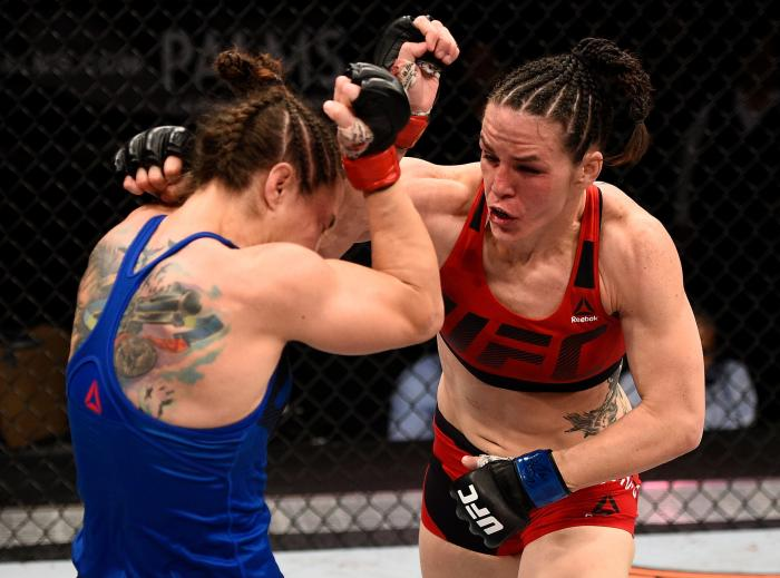 LAS VEGAS, NV - DECEMBER 03:  (R-L) Alexis Davis of Canada punches Sara McMann in their bantamweight bout during The Ultimate Fighter Finale event inside the Pearl concert theater at the Palms Resort & Casino on December 3, 2016 in Las Vegas, Nevada. (Photo by Jeff Bottari/Zuffa LLC via Getty Images)