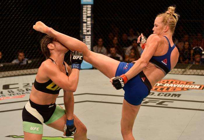 SINGAPORE - JUNE 17:   (R-L) Holly Holm knocks out Bethe Correia of Brazil with a kick in their women's bantamweight bout during the UFC Fight Night event at the Singapore Indoor Stadium on June 17, 2017 in Singapore. (Photo by Brandon Magnus/Zuffa LLC via Getty Images)
