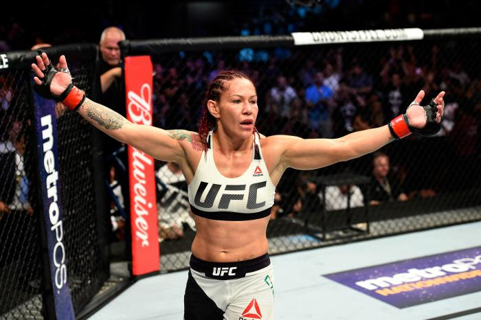 Cris Cyborg celebrates her win over Tonya Evinger in their UFC women's featherweight championship bout during the UFC 214 event at Honda Center on July 29, 2017 in Anaheim, California.