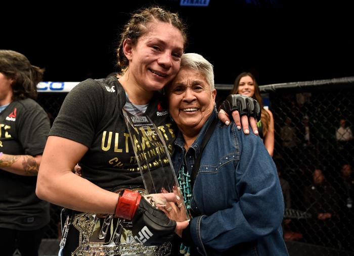 LAS VEGAS, NV - DECEMBER 01:  Nicco Montano celebrates with her grandmother after her unanimous-decision victory over Roxanne Modafferi in their women's flyweight championship bout during the TUF Finale event inside Park Theater on December 01, 2017 in Las Vegas, Nevada. (Photo by Jeff Bottari/Zuffa LLC via Getty Images)