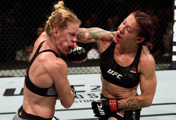 LAS VEGAS, NV - DECEMBER 30:  (R-L) Cris Cyborg of Brazil punches Holly Holm in their women's featherweight bout during the UFC 219 event inside T-Mobile Arena on December 30, 2017 in Las Vegas, Nevada. (Photo by Jeff Bottari/Zuffa LLC via Getty Images)