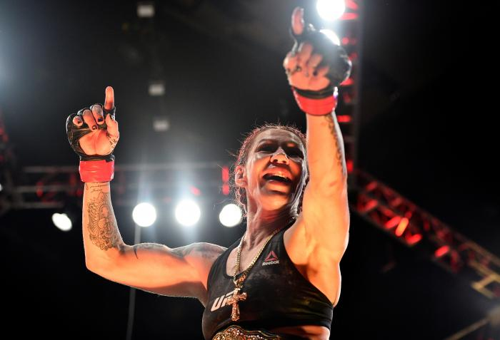 CURITIBA, BRAZIL - MAY 14:  (L-R) Cristiane 'Cyborg' Justino of Brazil celebrates after defeating Leslie Smith in their women's catchweight bout during the UFC 198 event at Arena da Baixada stadium on May 14, 2016 in Curitiba, Parana, Brazil.  (Photo by Josh Hedges/Zuffa LLC via Getty Images)
