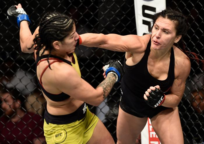 LAS VEGAS, NV - MARCH 03:   (R-L) Cat Zingano punches Ketlen Vieira of Brazil in their women's bantamweight bout during the UFC 222 event inside T-Mobile Arena on March 3, 2018 in Las Vegas, Nevada. (Photo by Jeff Bottari/Zuffa LLC via Getty Images)