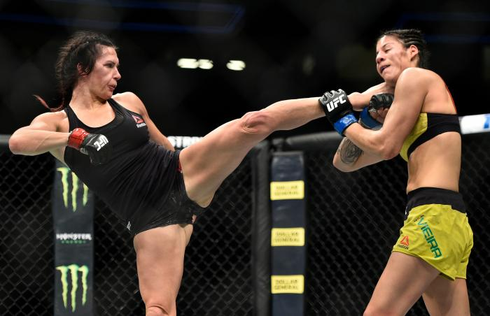 LAS VEGAS, NV - MARCH 03:   (L-R) Cat Zingano kicks Ketlen Vieira of Brazil in their women's bantamweight bout during the UFC 222 event inside T-Mobile Arena on March 3, 2018 in Las Vegas, Nevada. (Photo by Brandon Magnus/Zuffa LLC via Getty Images)