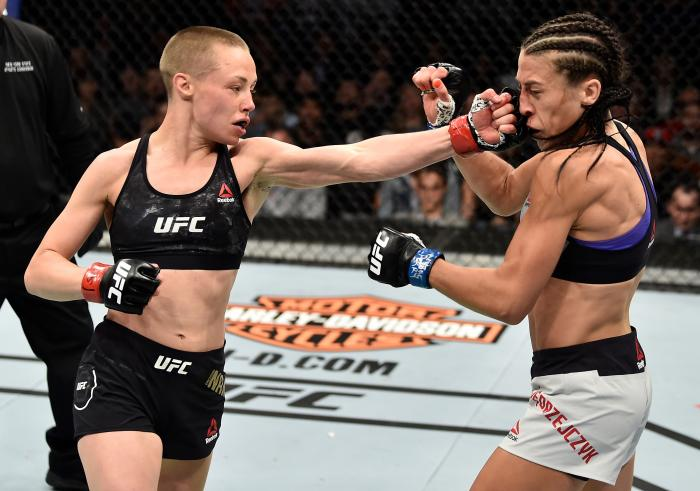 BROOKLYN, NEW YORK - APRIL 07:  (L-R) Rose Namajunas punches Joanna Jedrzejczyk of Poland in their women's strawweight title bout during the UFC 223 event inside Barclays Center on April 7, 2018 in Brooklyn, New York. (Photo by Jeff Bottari/Zuffa LLC via Getty Images)