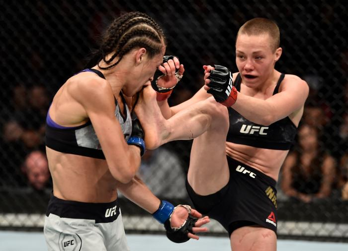 BROOKLYN, NEW YORK - APRIL 07:  (R-L) Rose Namajunas kicks Joanna Jedrzejczyk of Poland in their women's strawweight title bout during the UFC 223 event inside Barclays Center on April 7, 2018 in Brooklyn, New York. (Photo by Jeff Bottari/Zuffa LLC via Getty Images)